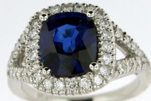 Custom blue gem and diamond ring