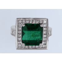 Emerald surrounded by diamonds square ring