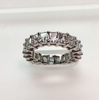 Eternity band with radiant cut diamonds