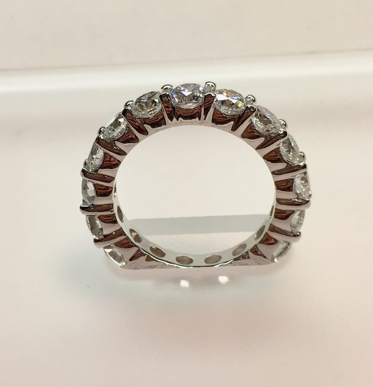 Solid sided eternity band with diamonds