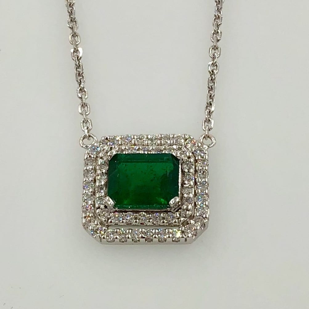 White gold pendant with emerald