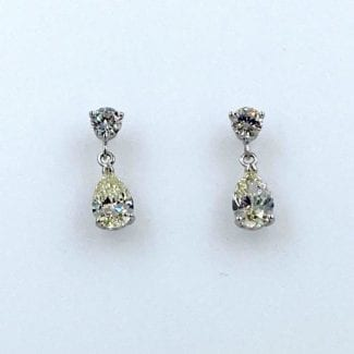 Round with Pear Shape Diamonds Earrings